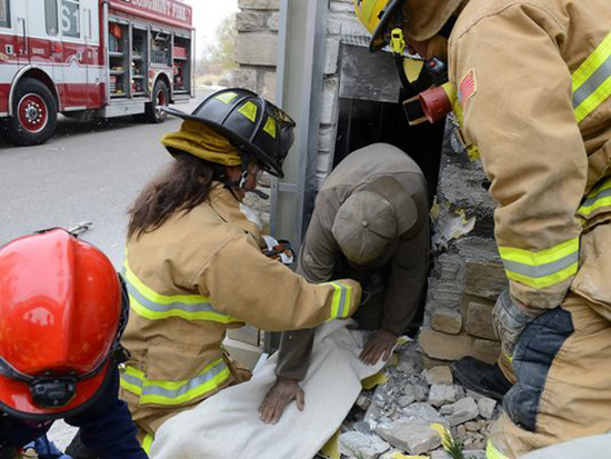Man trapped inside Marshall's store wall for 3 days crawls out after firefighters tear down part of exterior wall