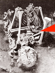 Aztec Death Whistle in hands of sacrificed victim