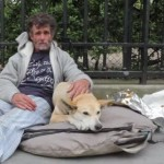 Homeless bodybuilder Sayagh Jacques on the streets of Paris with his dog