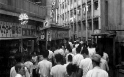 Coal miners travelling through Hashima to beigin their shift