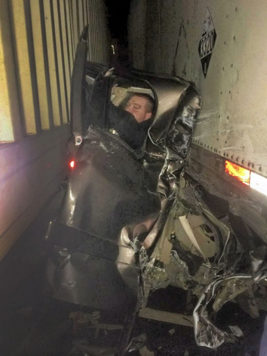 27-year-old Kaleb Whitby survived his pickup truck being crushed between two 18-wheeler semi-trucks