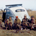 Researchers are asking the public for assistance in identifying the men in this photo of a group of hunters