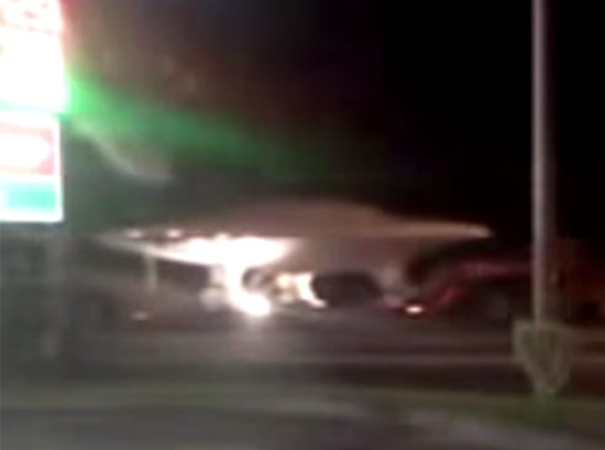 Disc-shaped UFO being transported in military convoy near Area 51