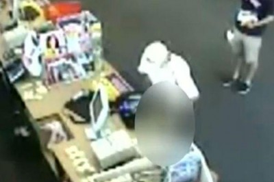 Photo of Durst peeing on the candy counter in Houston