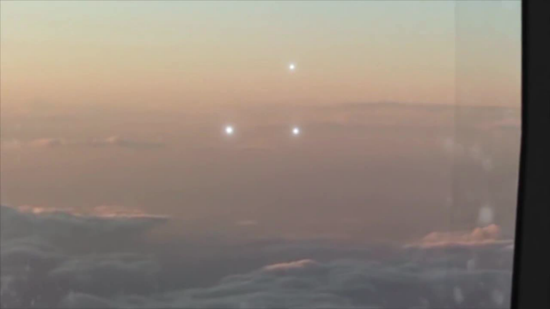 Interesting video out of Atlanta shows three bright white orbs following commercial airplane