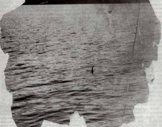 Famous Loch Ness Monster photo taken by Colonel Robert Wilson was later proven a fake.  Here is the original, uncropped version of the infamous Nessie photograph