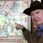 Forrest Fenn points to a spot on a map