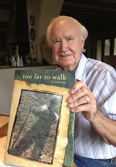 Forrest Fenn hodling up a copy of his new book - Too Far to Walk