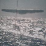 Submarine USS Trepang UFO photo - UFO flying above Arctic ocean