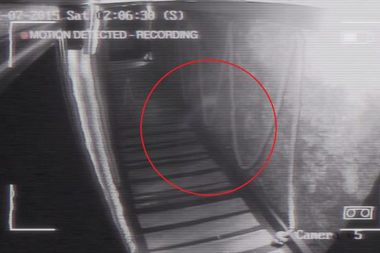 Security CCTV footage from haunted wine bar captures ghostly apparition gliding down hallway