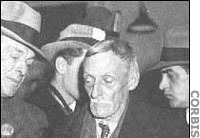 Det. King (left) arrests Albert Fish