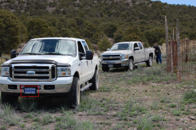 """Unusual vehicles at Groom Lake Mine - note the """"GROOM"""" license plate on the lead truck"""