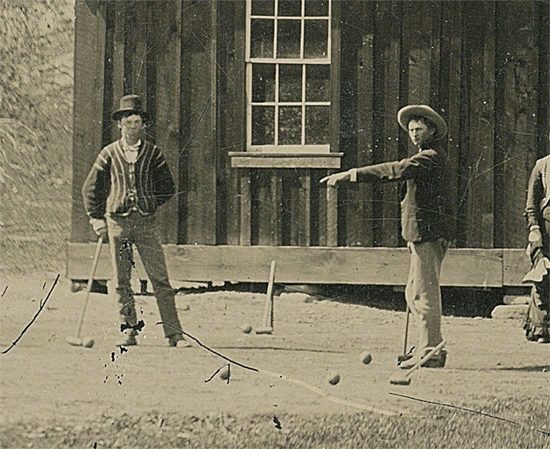 Cropped view of photo showing Billy the Kid (left) and a member of the Regulators gang playing croquet