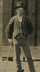 Cropped photo of Billy the Kid, croquet mallet in hand, on a ranch in New Mexico