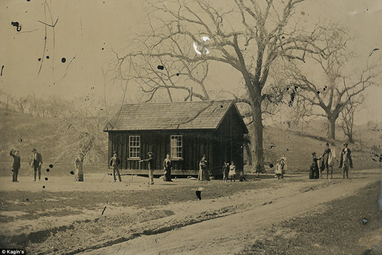 Billy the Kid and the Regulators gang playing croquet in front of schoolhouse on Roswell, New Mexico ranch
