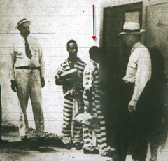 14-year-old George Stinney, indicated by the arrow, entering death row following his conviction of first-degree murder