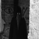 Pigpen cipher appears above character's left shoulder