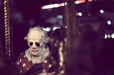 Wrinkles the Clown roaming the grounds of a fair