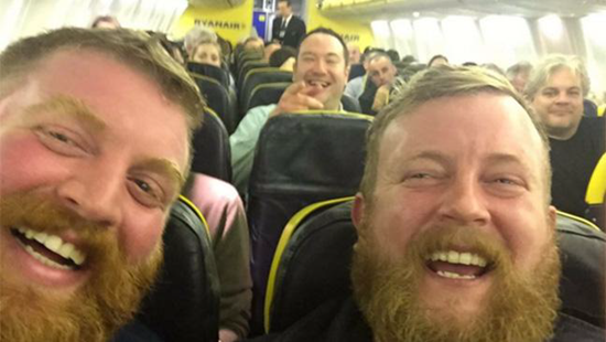 Guy on the right is the husband of my friend. Guy on the left is a STRANGER he met on a flight last night!