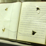 Theodore Roosevelt's 50-page speech with bullet holes (the speed was folded)