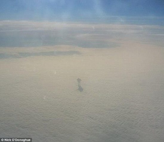 Plane passenger snaps picture of mysterious humanoid-like shadow figure walking on the clouds above Austria - photo courtesy Nick O'Donoghue