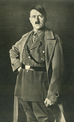 Adolph Hitler in an efeminate pose with hand on hip