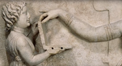 Differnt angle - 2,500-year-old Egyptian sculpture depicts young girl holding modern-day laptop computer