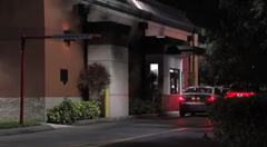 Man thru live alligator thru this Wendy's drive-thru window in Jupiter, Florida