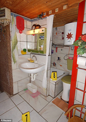 The small makeshift bathroom was decorated in bright colors and kid's drawings by Elisabeth