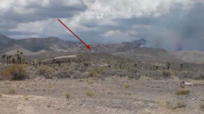 """The arrow in this picture points to the """"white truck"""" security team who blocked the road leading toward the fire"""