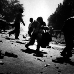 Photographer Kevin Carter shooting in the midst of conflict