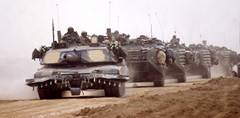 Abrams tank equipped with plows advancing towards Iraq