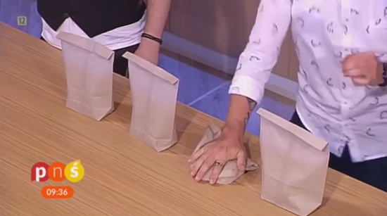 Poloniewicz choose random bag and smashes it with hand