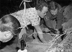 "Investigators recovering the body of Donald ""Shorty"" Shea"