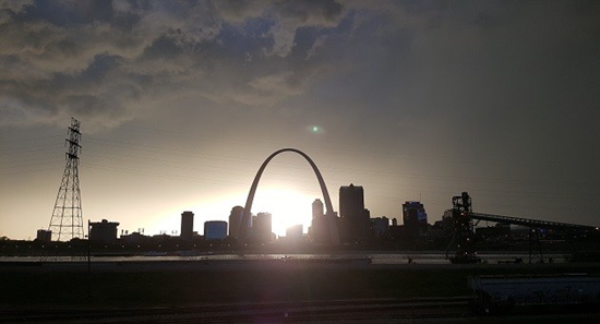 Daytime light orb over St. Louis' Arch