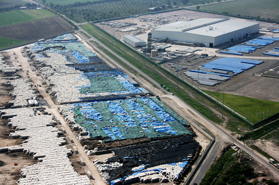 Aerial view of Mexican aluminum cache under tarps