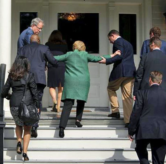Hillary Clinton caught by Secret Service guards after stumbling