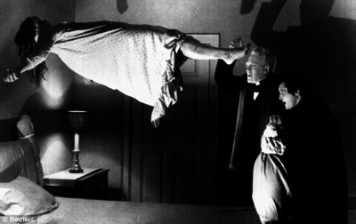 Linda Blair floating above bed in The Exorcist
