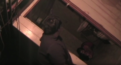 Man opening the door to reveal a girl bound in a basement bathroom