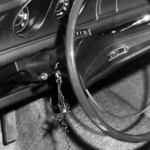 Twig hanging from driver's column in Sister Catherine's car