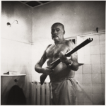 Ernest Hemingway posing with shotgun - probably the gun he killed himself with