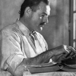 Ernest Hemingway working on his book For Whom the Bell Tolls