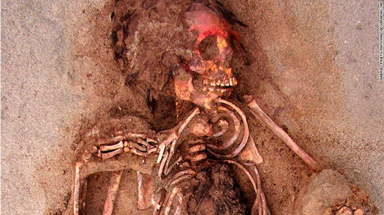 Child sacrifice victim with red-painted face thumb