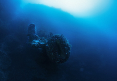 Circular underwater USO with obtrusions on side