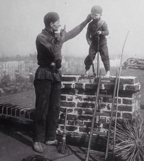 A master chimney sweep forces a child into a chimney for cleaning
