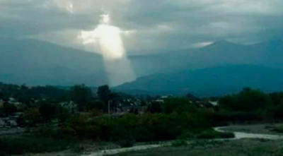 Sun streaming from clouds looks like Jesus Christ