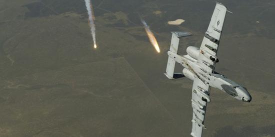 AC-10 Thunderbolt II jet dropping flares